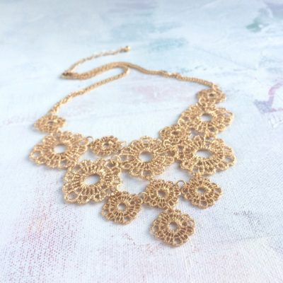 gold coloured lace necklace
